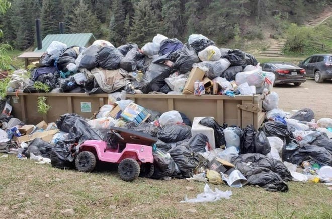A trash dumpster provided for the convenience of visitors to Lincoln National Forest overflows following Labor Day weekend.