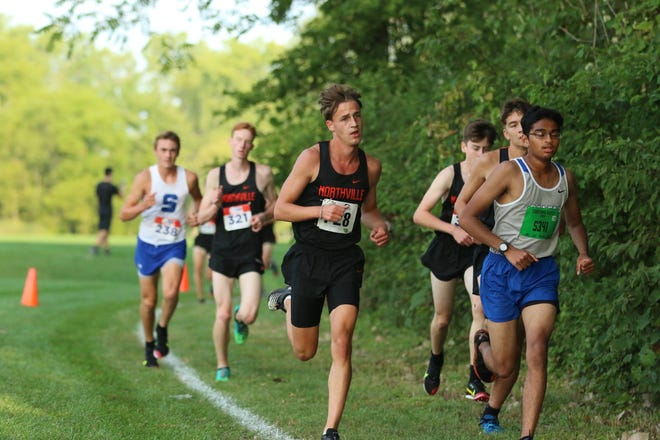 Senior Max Uphaus competes in the varsity race Saturday at Willow Metropark for the Mustangs.