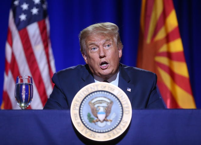 President Trump speaks to a crowd during a Latinos for Trump Roundtable at the Arizona Grand Resort in Phoenix on Sept. 14, 2020.