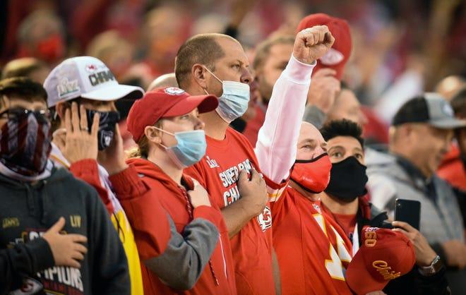 A Kansas City Chiefs fan raises a fist during the national anthem at the Chiefs' home opener Thursday, September 10, 2020 against the Houston Texans at Arrowhead Stadium in Kansas City, Missouri. (Tammy Ljungblad/The Kansas City Star/TNS)
