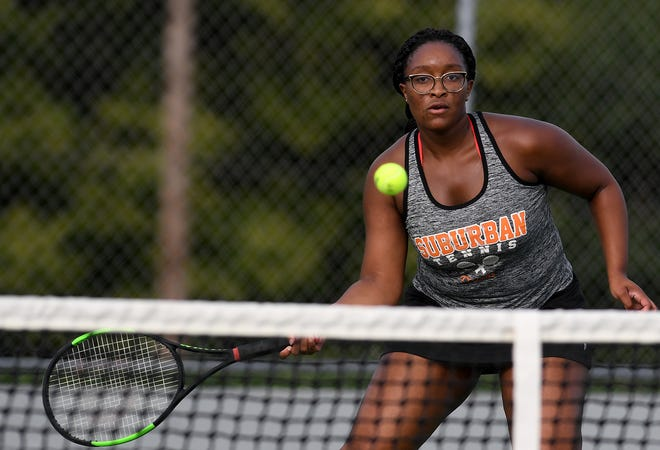Ini Efiom-Ekaha of York Suburban plays the net against Northeastern's Jiselle Castano, Monday, September 14, 2020. 