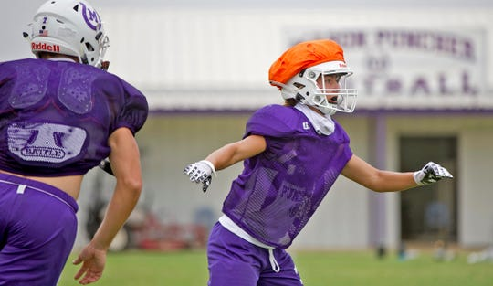 Tristin Keller, right, runs a drill during practice with the Mason High School football team on Thursday, Sept. 3, 2020.