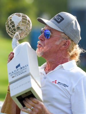 Miguel Angel Jimenez kisses the Sanford International trophy after winning the tournament on Sunday, September 13, at the Minnehaha Country Club in Sioux Falls.
