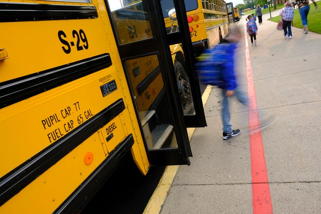 Students leave buses for their first day of in-person instruction Monday, Sept. 14, 2020, at Westwood Elementary School in St. Cloud.