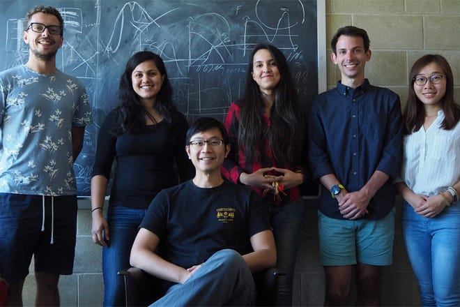 Assistant Professor of Physics Eric Hsiao, seated, with researchers, from left, Chris Ashall, Sahana Kumar, Melissa Shahbandeh, Scott Davis and Jing Lu.