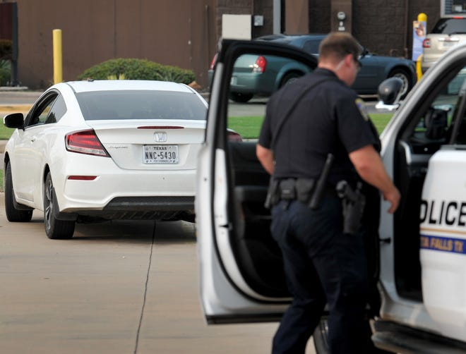 Wichita Falls police arrest two suspects during a traffic stop on Southwest Parkway Saturday afternoon.