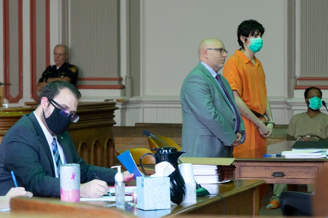 Justin Alcantar listens to Judge Mark Fleegle as he is sentenced in common pleas court.