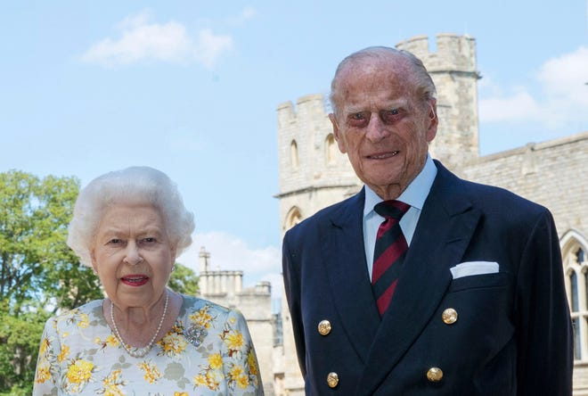 In this file photo from June 1, 2020, Queen Elizabeth and Prince Philip pose for a photo in the quadrangle of Windsor Castle ahead of the Duke of Edinburgh's 99th birthday.