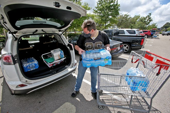 Tyler Anderson loads water and other supplies at Costco on Sunday, September 13, 2020, as New Orleans prepares for the arrival of what is expected to be Hurricane Sally.