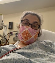 Jenny Berz, 50, in the emergency room while sick with COVID-19.