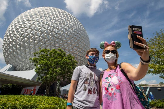 Walt Disney World theme parks, such as Epcot, require visitors to wear masks.