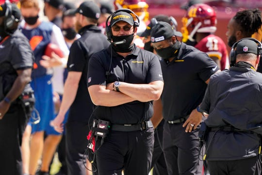 Washington Football Team head coach Ron Rivera, walking on the sidelines during the first half of an NFL football game against the Philadelphia Eagles, Sunday, Sept. 13, 2020, in Landover, Md.