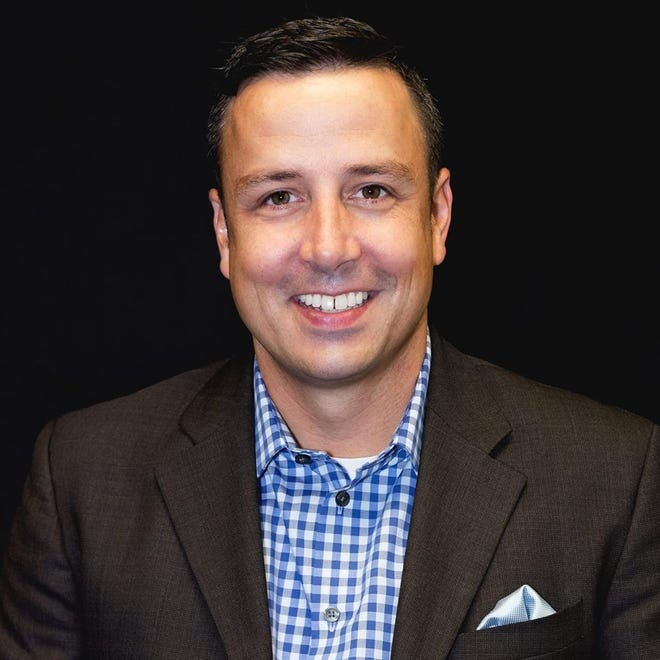 An undated photo of Adam Brown, vice president, real estate, at Cinch Home Services in Florida.