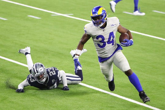 Malcolm Brown #34 of the Los Angeles Rams rushes for a 2-yard touchdown during the third quarter against the Dallas Cowboys at SoFi Stadium on September 13, 2020 in Inglewood, California.