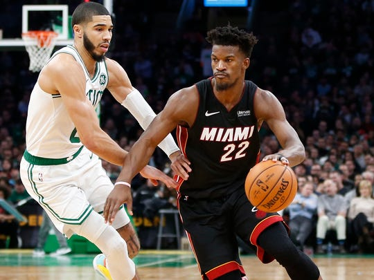 Jayson Tatum (0) and the Celtics won two of three matchups against Jimmy Butler (22) and the Heat during the regular season.