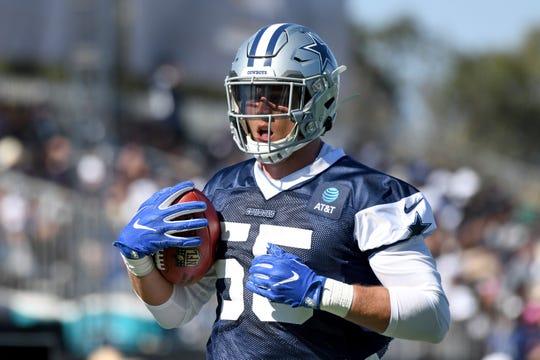 Dallas Cowboys linebacker Leighton Vander Esch runs a drill at the NFL football team's training camp in Oxnard, Calif., Saturday, July 27, 2019.