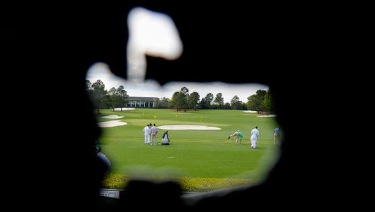 The view through a cutout at the practice range at Augusta National Golf Club.