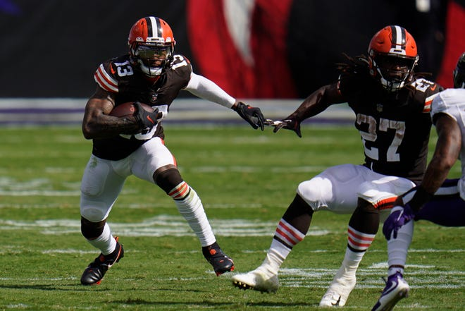 Cleveland Browns wide receiver Odell Beckham Jr. (13) runs the ball, during the second half of an NFL football game against the Baltimore Ravens, Sunday, Sept. 13, 2020, in Baltimore, MD. (AP Photo/Julio Cortez)