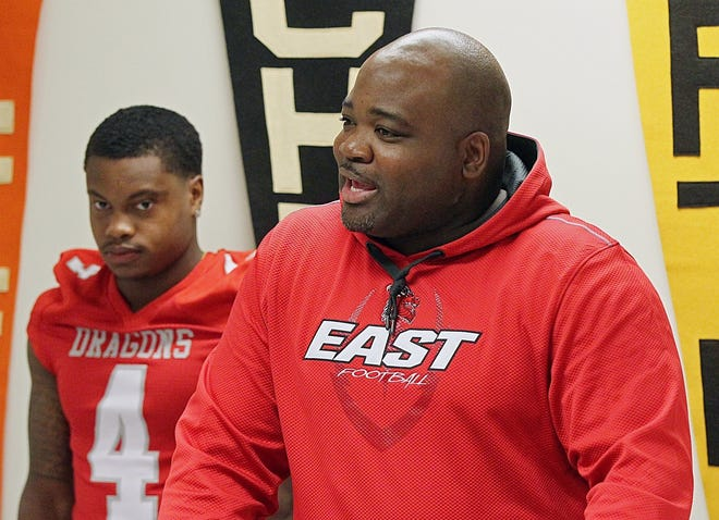East football coach Marques Hayes will lead the Dragons against Firestone in the City Series opener Thursday night at Ellet High School. [Jeff Lange/Beacon Journal]