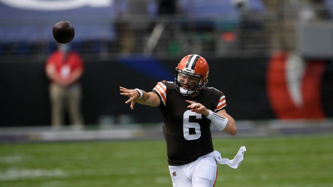 Browns quarterback Baker Mayfield makes a pass during Sunday's loss to the Baltimore Ravens. [Nick Wass/Associated Press]