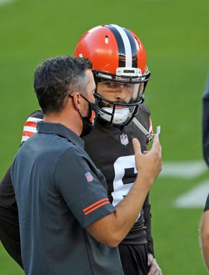 Browns coach Kevin Stefanski talks to quarterback Baker Mayfield before a scrimmage Sept. 4 at FirstEnergy Stadium in Cleveland. [Joshua Gunter/Cleveland.com file photo via AP]