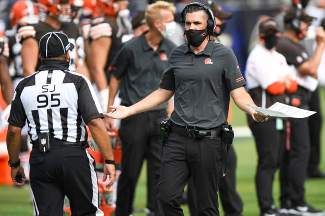 FILE - Cleveland Browns head coach Kevin Stefanski discusses a call with an official in the second half during an NFL football game against the Baltimore Ravens, Sunday, Sept. 13, 2020, in Baltimore. Stefanski didn't need long to be lumped together with so many Browns coaches before him. One game into his tenure, he's 0-1, being criticized for a head-scratching decision and faced with a lengthy list of problems. The Ravens beat the Browns  38-6.(AP Photo/Terrance Williams, File)