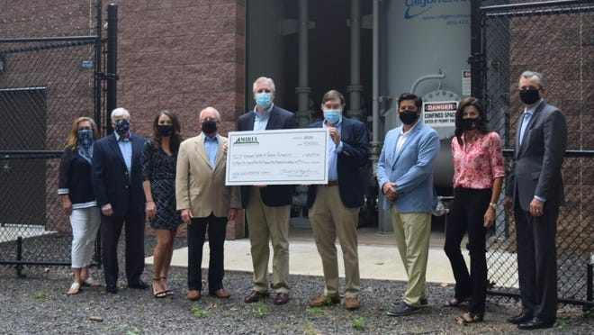 MIRIA Chairman and State Rep. Todd Stephens, R-151, of Horsham, presents a check to Horsham Water & Sewer at the Public Well House in Meetinghouse Park.  The money will be refunded to customers who paid surcharges to remove PFAS from drinking water.