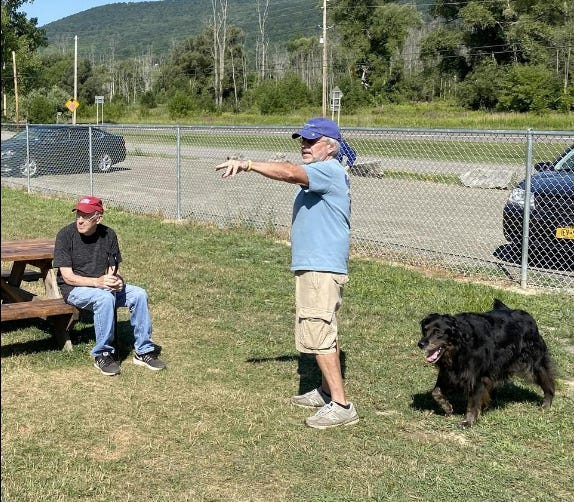 Paul Wilson (standing), an organizer of the Presley Memorial Dog Park, speaks with Bill Romig, the man who first came up with the idea of having a dog park in Hammondsport.