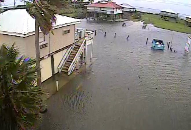Flood waters at the Cajun Holiday motel in Grand Isle Tuesday morning. La. 1 was covered by over a foot of water, according to reports.