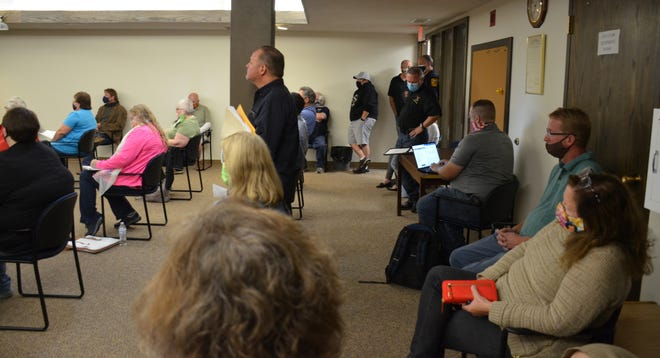 With chairs spaced out for socially distancing purposes, some people had to stand in the council chambers Monday night
