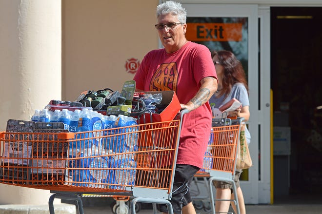 Women purchase storm supplies ahead of Hurricane Dorian at Home Depot in Leesburg on Friday, Aug. 30, 2019. [Whitney Lehnecker/Daily Commercial]