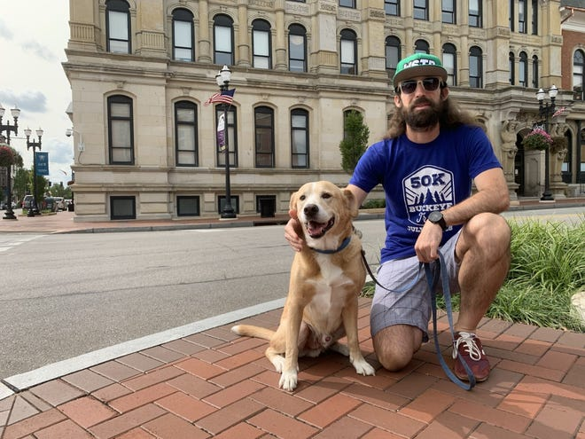 Nathan Quinn with his dog Roscoe will host Quinn's Dog Running 5K event to benefit the Wayne County Humane Society. Quinn adopted Roscoe from the shelter five years ago.