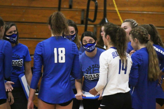 Van Meter head volleyball coach Sara Cook talks to her team during a time out against ACGC on Monday, Sept. 14 in Guthrie Center.