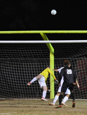 North Davidson keeper Cain Pfost makes a save by knocking the ball over the crossbar in a third-round 2-A state playoff game at Salisbury.