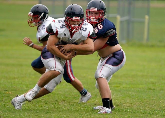 Trinity Catholic contained a dominant Taylor running game on Friday.