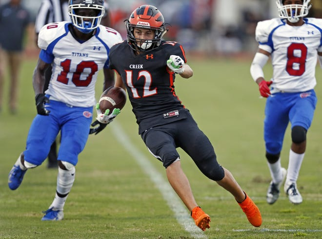 Spruce Creek's Kevin Minckler (12) had a pair of touchdowns in Creek's win over Fort Pierce Central.