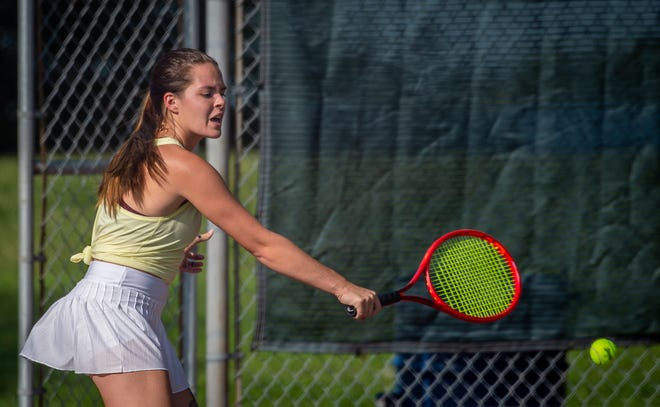 Blue Springs No. 1 singles player Allie Brown reaches for a backhand return in Monday's match against Grain Valley's Chelsea Gorden at Baumgardner Park. Brown claimed an 8-2 win to help the Wildcats claim a 5-4 victory.
