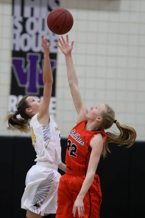 Central Lee's Mya Merschman (24) and Mediapolis High School's Helaina Hillyard (32) during the tipoff Jan. 25, 2019 at Iowa Wesleyan University.