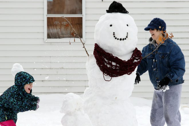 Lillian Anderson, 4, and her grandmother, Nancy McKee, take a break from building a snowman and engage in a snowball fight, Jan. 17, 2019, in Burlington. While weather may cause students to stay home from school this year, it won't mean they'll get the day off. The Iowa Department of Education has decided would-be weather-related school cancellations instead will be designated as digital days.