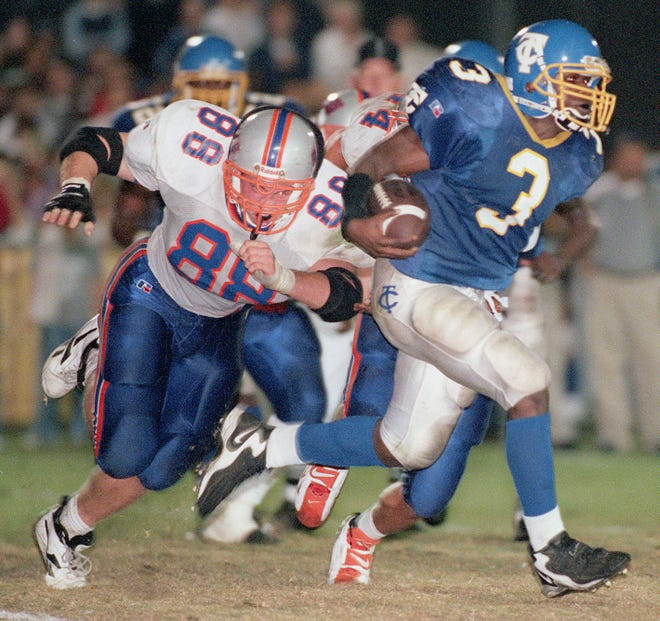 Bolles defensive lineman Jonathan Younkins (88) tries to tackle Trinity Christian running back Caron Bracy (3) in the teams' meeting on Oct. 30, 1998, the last time any Jacksonville team defeated Trinity by 24 or more points.