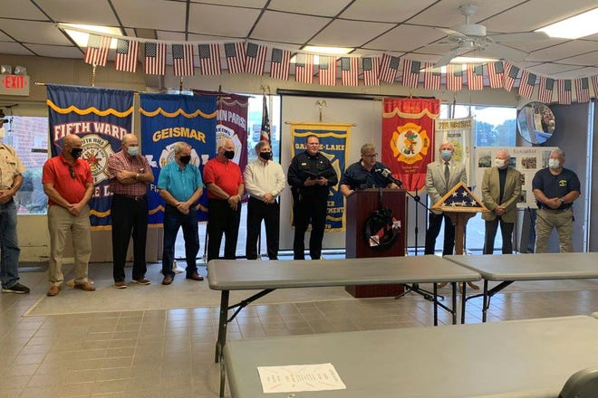 St. Amant Fire Chief and Constable James LeBlanc, surrounded by several local dignitaries, speaks during the 9/11 commemoration ceremony last week.