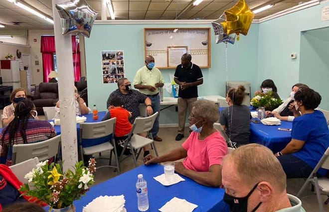 The Onslow Community Outreach staff and volunteers recently held a farewell party for their executive director Theo McClammy. [Contributed photo]