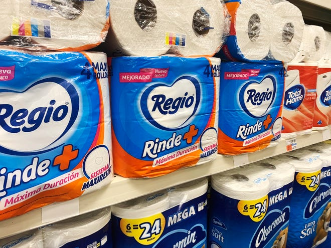 Regio, a Mexican toilet paper brand, fills a shelf at a CVS in New York earlier this month. Demand for toilet paper has been so high during the pandemic that in order to keep their shelves stocked, retailers across the country are buying up foreign toilet paper brands, mostly from Mexico.