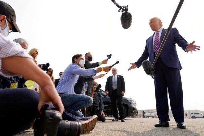 President Donald Trump speaks to reporters as he arrives at Sacramento McClellan Airport, in McClellan Park, Calif., Monday for a briefing on wildfires.