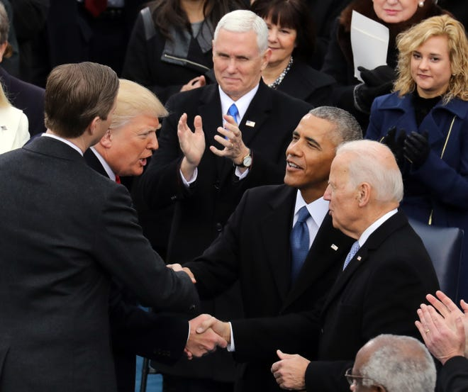 President Donald Trump is congratulated by former President Barack Obama and former Vice President Joe Biden after being sworn in on Jan. 20, 2017, in Washington, D.C.