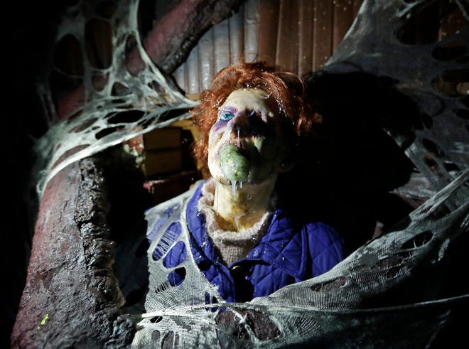 """In this Sept. 12, 2018, file photo, the character Barb appears in grand, gory style in the """"Stranger Things"""" haunted house during Halloween Horror nights at Universal Studios in Orlando. Universal will make two of its previously canceled Halloween Horror Nights haunted houses available to theme-park goers starting later this week."""