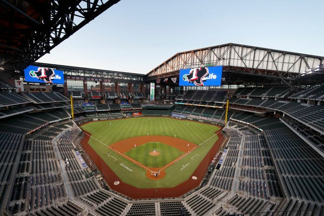 The Seattle Mariners play the Texas Rangers in the first inning of a baseball game at Globe Life Field in Arlington, Texas, on Aug. 10. The World Series will be played entirely at the Texas Rangers' new ballpark in Arlington, Texas, as part of a bubble agreement between Major League Baseball and the players' association, the first time the sport's championship will be played entirely at one site since 1944.