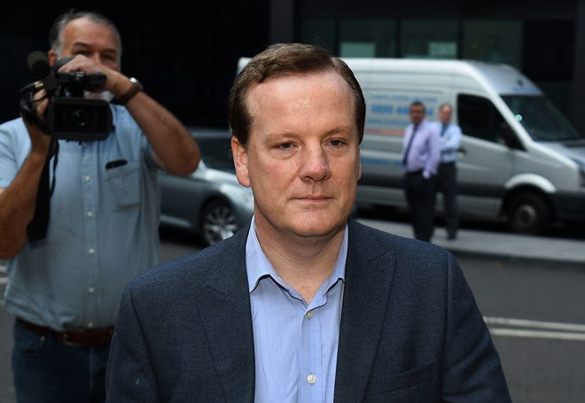 Former Conservative Party lawmaker Charlie Elphicke arrives at Southwark Crown Court in London to be sentenced on three counts of sexual assault Tuesday. Elphicke was sentenced to two years in prison on Tuesday for sexually assaulting two women a decade apart.