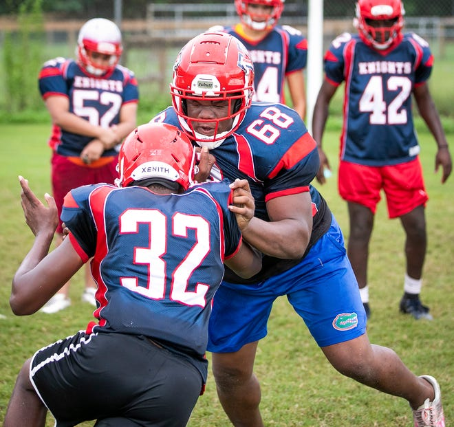 Vanguard defensive end Bryce Langston tries to drive an offensive lineman during a drill at football practice. The Knights open their season against the Forest Wildcats on Friday, Oct. 2.