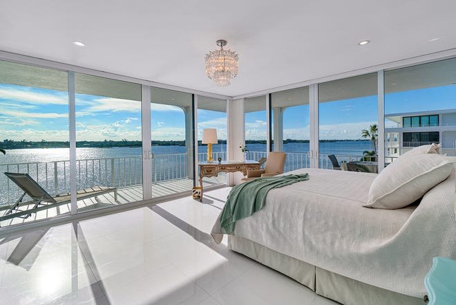 The master bedroom's corner location captures nearly panoramic views of the Intracoastal Waterway. The condo, No. 402S at the Cove, is listed at $1.495 million.  [Photo courtesy Sotheby's International Realty]